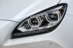 Led car headlight. Headlight with led lamps and hood of white sport modern car Stock Images