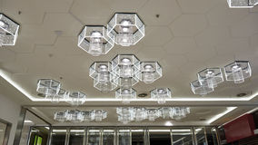 Led ceiling lighting. Hexagon led light used on shopping mall ceiling, as a new kind of commercial light, led makes the business even greener Stock Image