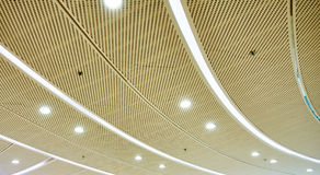 LED ceiling lighting. Modern commercial ceiling with LED light for indoor lighting stock photos