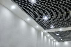 Led ceiling lights on modern commercial building suspended ceiling royalty free stock images