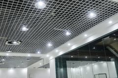 led ceiling lights on modern commercial building suspended ceiling stock photos
