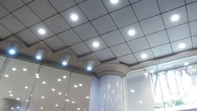 Led ceiling lights on modern commercial building ceiling stock photo