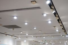 Led ceiling spot lighting in modern building Modern architecture roof royalty free stock photo