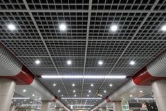 Led ceiling spot lighting in modern building Modern architecture roof stock photos