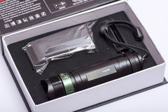 LED cree flashlight torch green button Royalty Free Stock Photo