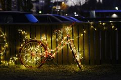 LED decorated pink bike for Christmas. Near the parking lot royalty free stock images