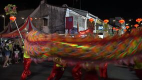LED Dragon dance action at street during chinese new year.