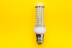 LED economy lamp. Bulb Electric lamp led corn on a yellow background, at 5050 chips Stock Images