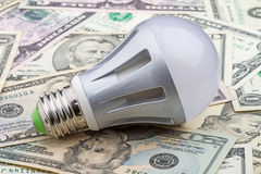 LED electric bulb on dollar Stock Photography