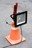 LED energy saving industrial flood light mounted on orange strip Stock Photo