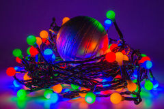 LED fairy lights. With glittery silver bauble stock photography
