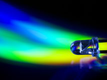 Led flame. Transparent  light-emitting diode (LED) on abstract color background Royalty Free Stock Photography