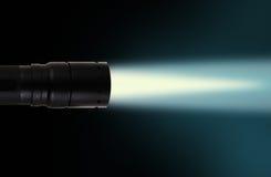 LED flashlight beam on black background Royalty Free Stock Photos