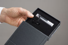 LED flashlight in the black box Stock Photo