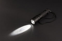 LED flashlight with a light beam Stock Image