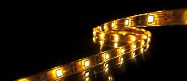LED garland. Glowing LED garland on black background Stock Photo