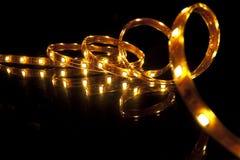 LED garland. Glowing LED garland on black background Stock Images