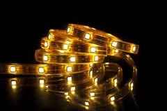 LED garland. Glowing LED garland on black background Royalty Free Stock Images