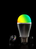 Led ha colorato la lampadina su un supporto Fotografia Stock