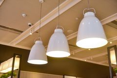 Led hanging lighting in commercial building. Modern pendant led lighting in a commercial building restaurant royalty free stock photos