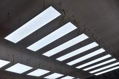 Led hanging lighting in commercial building royalty free stock images