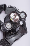 LED head lamp torch. Black LED head lamp torch royalty free stock photography