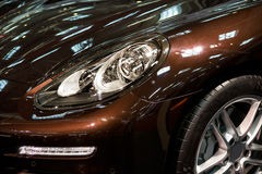 Led headlight of car. Brown car with shiny led headlight Stock Image
