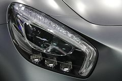 LED headlights on modern german exclusive coupe car royalty free stock photos