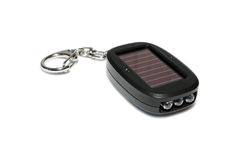Led keychain micro flash. Keychain Solar-powered flashlight. Close-up stock photo