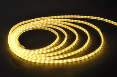 Led lamp belt,yellow light led belt, led strip, waterproof yellow LED light strips. Yellow Luminous on background professional,orange  light led belt ,Energy Stock Photos