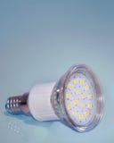Led lamp closeup on blue background.Saving energy bulb. Royalty Free Stock Photo