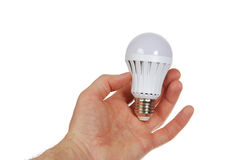 Led lamp in hand Stock Images