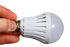 Led lamp in hand Royalty Free Stock Photography