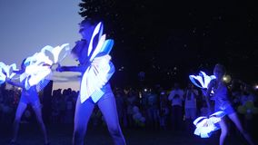 LED lamp In hands of girls in night in open air, Fire art At festival in nature for people, vivid Fire show in darkness. Kherson, Ukraine - 8 July 2017: Festival stock video