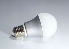 LED lamp on isolated gray background, ECO energy concept, close Royalty Free Stock Image