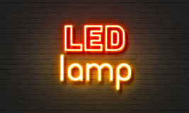LED lamp neon sign on brick wall background. Stock Image