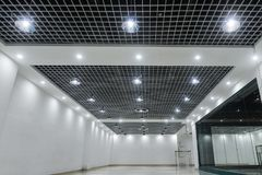 Led ceiling lights on modern commercial building ceiling royalty free stock image