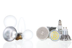 LED lamps versus conventional lamps on white Royalty Free Stock Photography