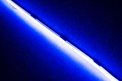 Blue light science technology background. Led light blue light science technology background. Abstract of blue led light of ceiling. Diagonal shape or Light Royalty Free Stock Images