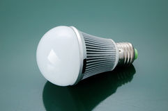 Led light bulb. With green background Royalty Free Stock Photo