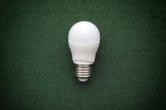 LED light bulb on a green background Stock Images