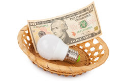 LED light bulb and money in basket Stock Photos