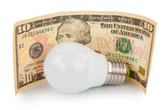 LED light bulb and money Royalty Free Stock Photography