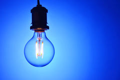 Led light bulb. New led light bulb over blue background Stock Images