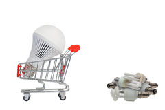 LED light bulbs on a cart and a pile of old bulbs. Royalty Free Stock Photography