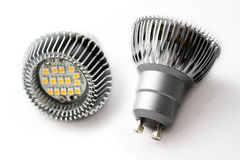 LED Light Bulbs Metal. Close-up of two LED light bulbs against a white background stock image