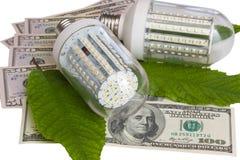 Led light and dollars. On white background Royalty Free Stock Photo