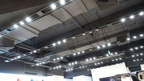 Led light on shop ceiling in modern commercial building. Led lamps are installed on  square shape ceiling in modern  commercial building as hotel shopping mall royalty free stock images