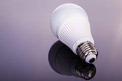 Led lightbulb on dark Stock Image