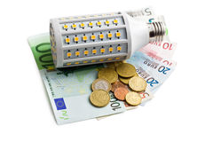 LED lightbulb with euro money Royalty Free Stock Images